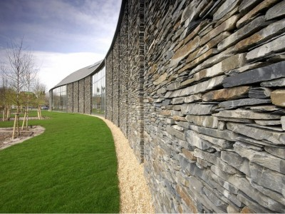 External slate wall with feature windows overlooking courtyard