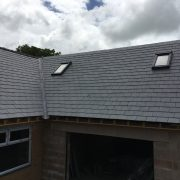 Slate roof with skylights during construction
