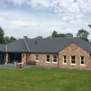 Kentdale Slate roof in place on countryside home - back garden view