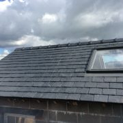 Close up of slate roof with velux windows