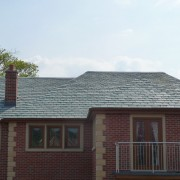 House with Vermont Structural Unfading Green roof
