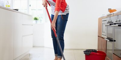 Lady Cleaning Floor
