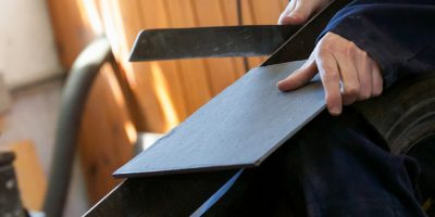 Slate dressing and splitting with a hammer and blunt chisel