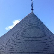 Building turret with slate roof tiles